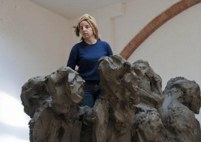 """Jørgen Haugen Sørensen's wife, Eli Benveniste, working on the sculpture """"The Crowd"""""""