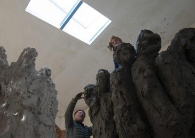 """Jørgen Haugen Sørensen and his wife, Eli Benveniste, working on the sculpture """"The Crowd"""""""